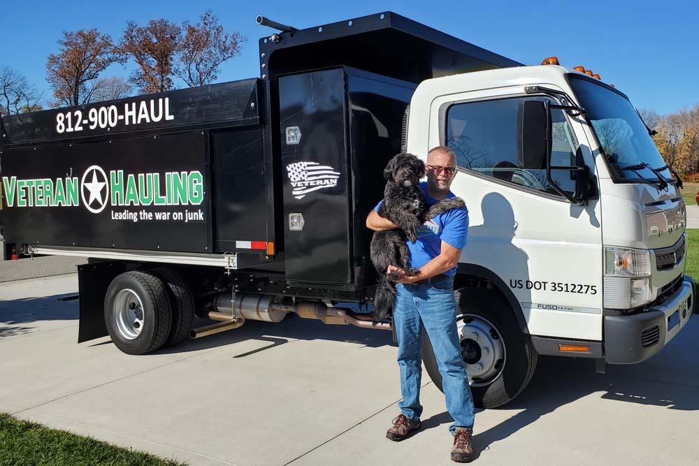 Veteran Hauling LLC founder and dog